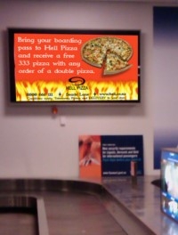 Illuminated Sign at Queenstown Airport for Hell Pizza